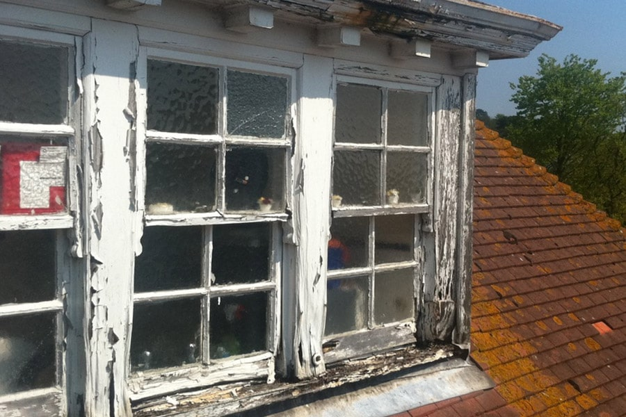 Image of sash window in need of repair